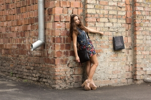 beauty-girl-posing-fashion-near-red-brick-wall-1441658-m