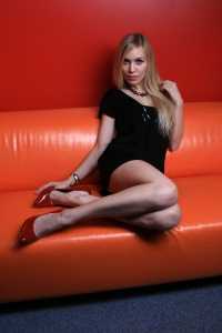 girl-on-orange-sofa-2-1268858-m